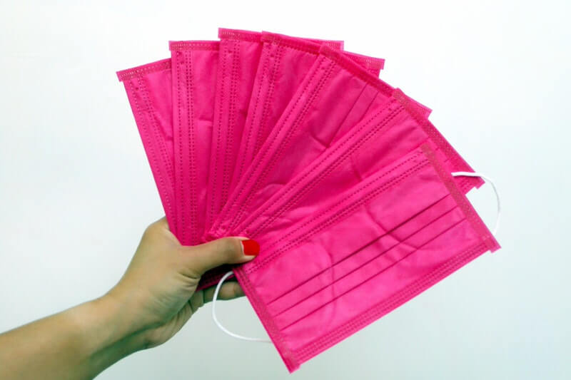 Buying a Pink Face Mask - Image 1